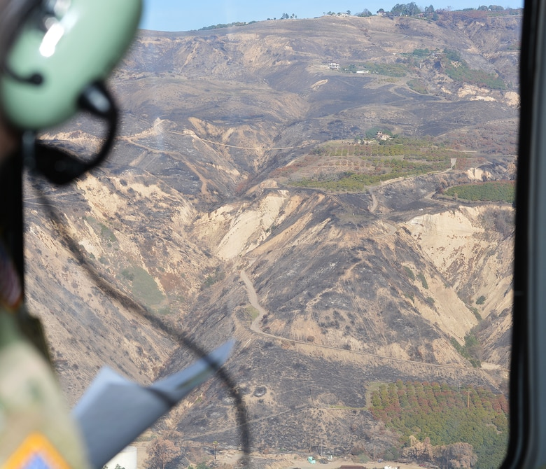 Burn scars on the mountainsides overlooking Santa Barbara County can be seen Jan. 18 from a UH-60 Blackhawk helicopter.