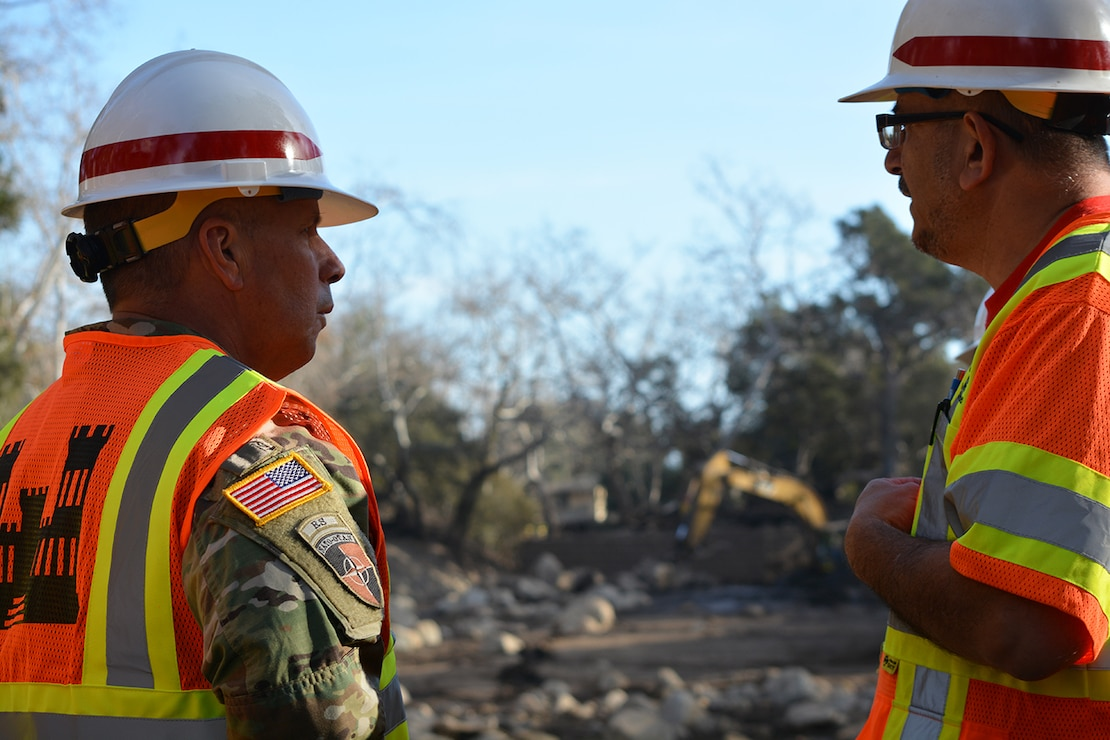 Lt. Gen. Todd Semonite, commanding general, U.S. Army Corps of Engineers, talks to a Corps of Engineers Los Angeles District employee about one of the basins he is working at during Semonite's Jan. 18 visit to Montecito, California, to view the disaster caused by a Jan. 9 mudslide.