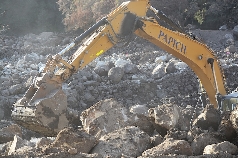 A bulldozer clears boulders out of the Cold Springs Creek Basin Jan. 18 in Montecito, California.