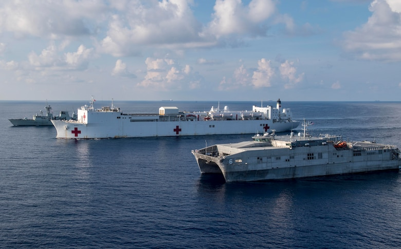 Military Sealift Command hospital ship USNS Mercy (T-AH 19), Her Majesty's Canadian ship HMCS Vancouver (FFH 331), and Military Sealift Command expeditionary fast transport USNS Brunswick (T-EPF 6) sail in formation during a passing exercise (PASSEX) conducted in support of Pacific Partnership 2018 (PP18). PP18's mission is to work collectively with host and partner nations to enhance regional interoperability and disaster response capabilities, increase stability and security in the region, and foster new and enduring friendships across the Indo-Pacific Region. Pacific Partnership, now in its 13th iteration, is the largest annual multinational humanitarian assistance and disaster relief preparedness mission conducted in the Indo-Pacific.