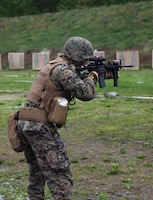 U.S. Marine Sgt. Derek R. Rush, marksmanship coach with Headquarters and Service Company, 6th Engineer Support Battalion, 4th Marine Logistics Group, Marine Forces Reserve, shoots at his target during a live fire range of tables five and six during exercise Red Dagger at Fort Indiantown Gap, Pa., May 14, 2018.