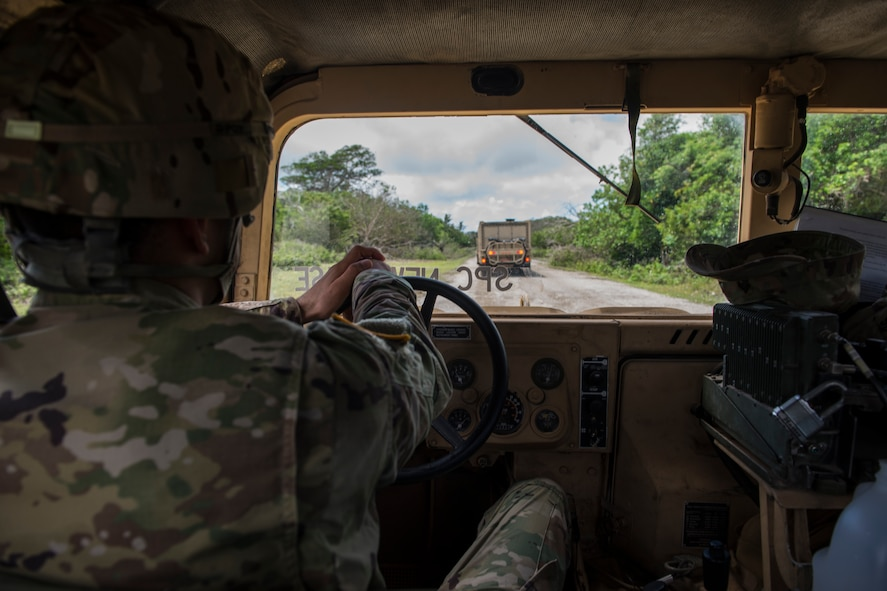Soldiers assigned to the 94th Army Air and Missile Defense Command, Task Force Talon, travel in a convoy during a Typhoon readiness exercise, 9 May, 2018, on Andersen Air Force Base, Guam. The exercise allowed soldiers to coordinate and practice procedures they may have to implement to protect assets and personnel in the event of severe weather. (U.S. Air Force photo/Senior Airman Zachary Bumpus)