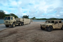 Soldiers from the 94th Army Air and Missile Defense Command, Task Force Talon, return to their staging area during a Typhoon readiness exercise, 9 May, 2018, on Andersen Air Force Base, Guam. The exercise helped the soldiers practice the close coordination and different procedures they may have to implement to protect assets and personnel in the event of severe weather. (U.S. Air Force photo/Senior Airman Zachary Bumpus)
