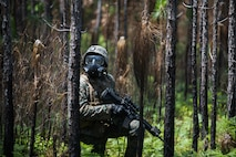 Lance Cpl. Joshua Hill, an infantry Marine with India Company, 3rd Battalion, 8th Marine Regiment, 2nd Marine Division stands by to move away from CS gas during Marine Corps Combat Readiness Evaluation on Camp Lejeune, N.C., May 11, 2018.