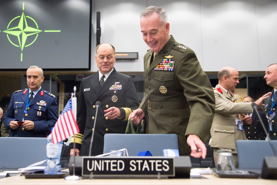 Marine Corps Gen. Joe Dunford, chairman of the Joint Chiefs of Staff, arrives at a NATO meeting.