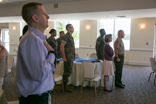 Members of the community and service members on Marine Corps Air Station New River stand for the national anthem during the National Day of Prayer at the Officers' Club on MCAS New River, May 3. The National Day of Prayer is an annual event taking place on the first Thursday of May. (U.S. Marine Corps photo by Lance Cpl. Nicholas Lubchenko)
