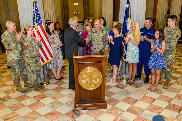 South Carolina Gov. Henry McMaster presents a proclamation recognizing May as Military Spouse Appreciation month throughout South Carolina, joined by U.S. Army Maj. Gen. Robert E. Livingston, Jr. the adjutant general for South Carolina and his wife Barbara, Fort Jackson's Military Family of the Year, Staff Sgt. John Berta and his wife Agata, U.S. Coast Guard Petty Officer Jerry Stevens and his wife Sarah, and other military members with the spouses from the South Carolina Army and Air National Guard.