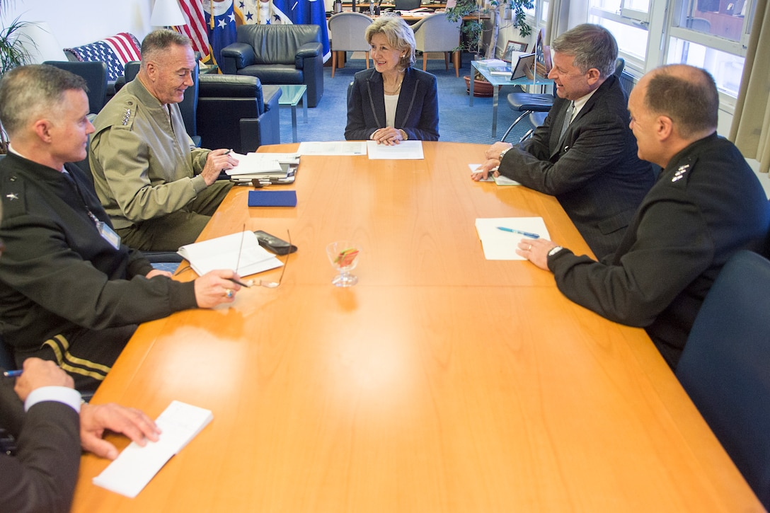 Marine Corps Gen. Joe Dunford, chairman of the Joint Chiefs of Staff, meets with Ambassador Kay Bailey Hutchinson in Brussels.