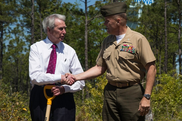 Col. Michael Scalise, Deputy Commander of Marine Corps Installations East, Camp Lejeune shakes hands with Walter Jones, a congressman with the House of Representatives after planting Longleaf Pine Seedlings at the Stones Creek Game Land on Sneads Ferry, North Carolina, April 30. (U.S. Marine Corps photo by Cpl. Breanna L. Weisenberger)