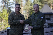 Colonel John J. Carroll, the deputy commander of Marine Forces Europe and Africa, presents Maj. Gen. Petri Hulkko, the commander of the Finnish Army, with a gift as part of a distinguished visitor tour for Exercise Arrow 18 in Finland, May 15, 2018. Exercise Arrow is an annual multi-national exercise with the purpose of training platoon- to battalion-sized mechanized infantry, artillery, and mortar field training skills with a live fire exercise. (U.S. Marine Corps photo by Sgt. Averi Coppa/Released)