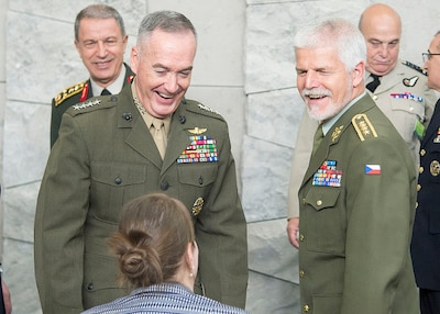 Marine Corps Gen. Joe Dunford, chairman of the Joint Chiefs of Staff, left, arrives to attend the 179th Military Committee in Chiefs of Defense meeting at NATO's new headquarters building in Brussels, May 16, 2018. Standing next to Dunford is Czech Gen. Petr Pavel, the chairman of NATO's Military Committee.