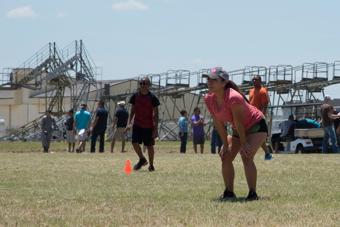 U.S. Air Force Tech. Sgt. Crystal Schendel, 433rd Maintenance Group maintenance scheduler, is ready to kick the ball during the 433rd Airlift Wing Family Fun Day kickball tournament May 6, 2018, at Joint Base San Antonio-Lackland, Texas. Reserve Citizen Airmen of the Alamo Wing and their families participated in multiple sporting competitions, as well as enjoyed free food and other activities, during the annual event. (U.S. Air Force photo by Tech. Sgt. Iram Carmona)