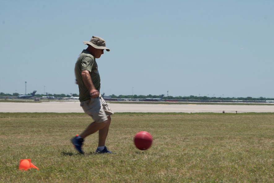U.S. Air Force Tech. Sgt. Timothy W. McKay, 433rd Maintenance Group maintenance management analysis technician, kicks the ball during the 433rd Airlift Wing Family Fun Day kickball tournament May 6, 2018, at Joint Base San Antonio-Lackland, Texas. Reserve Citizen Airmen of the Alamo Wing, along with their dependents, participated in the tournament and other festivities during the annual event. (U.S. Air Force photo by Tech. Sgt. Iram Carmona)