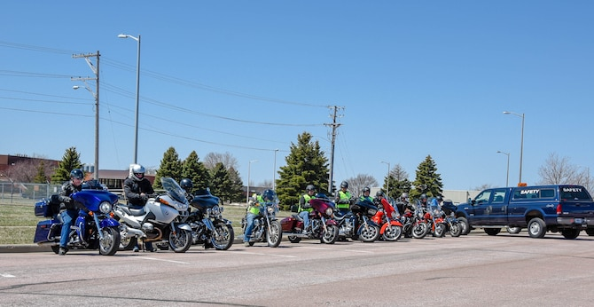 South Dakota Air National Guard motorcycle riders prepare to depart for the mentorship ride after participating in the annual motorcycle training at Joe Foss Field, S.D.