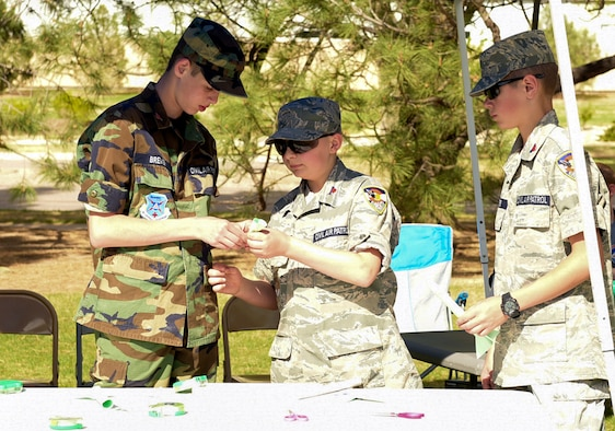 PETERSON AIR FORCE BASE, Colo. – Cadets from the U.S. Air Force Auxiliary Civil Air Patrol assemble a pneumatic actuated rocket at Peterson Air Force Base, Colo., May 9, 2018. The cadets were setting up this display for Peterson AFB STEM Day. (U.S. Air Force photo by Cameron Hunt)