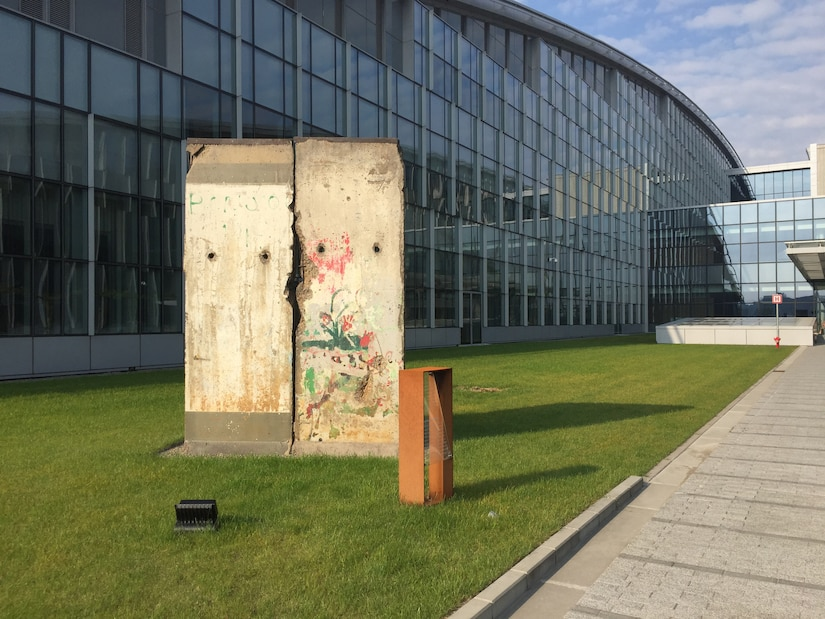 A remnant of the Berlin Wall flanks the entrance to the new NATO headquarters building in Brussels.