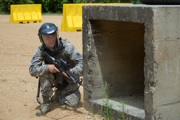 An Airman from the 4th Civil Engineer Squadron prepares to fire on simulated targets during a shoot house competition during Police Week, May 15, 2018, at Seymour Johnson Air Force Base, North Carolina.