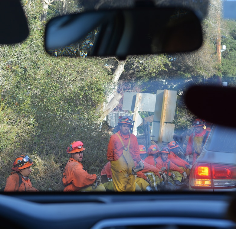 : Emergency responders take a break from recovery efforts Jan. 18 in Montecito, California.