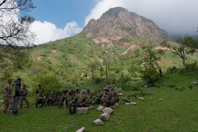 Tajik and U.S. soldiers conduct an after-action review at a mountain training camp outside of Dushanbe, Tajikistan, April 20, 2018. This information exchange was part of a larger military-to-military engagement taking place with the Tajikistan Peacekeeping Battalion of the Mobile Forces and the 648th Military Engagement Team, Georgia Army National Guard, involving border security tactics and techniques.
