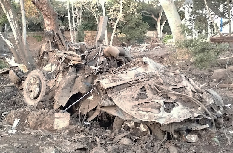 A vehicle sits mangled and destroyed in a yard following a Jan. 9 mudslide in Montecito, California.