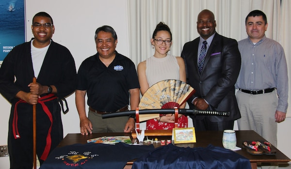 IMAGE: VIRGINIA BEACH, Va. (May 9, 2018) - Employees of Naval Surface Warfare Center Dahlgren Division (NSWCDD) Dam Neck Activity gave presentations on their heritage in Japan and the Philippines during the command's Asian American and Pacific Islander Heritage Month celebration. Pictured from left to right: Martial artist Jonathan Armstrong, Filipino-American presenter Pert Asiatico, and Japanese-American presenter Katherine Johnson with Marcus Matthews and Roberto Garcia of the NSWCDD Dam Neck Activity Diversity Committee. Johnson and Asiatico spoke on the rich cultural heritages of Japan and the Philippines, which they have experienced first-hand. Filipino food was enjoyed by many after the presentations.