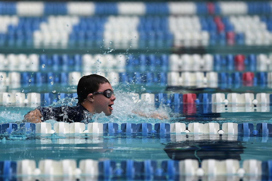 Easton Slutz, District 5 Special Olympics Mississippi athlete, swims in the 4x100 freestyle relay during SOMS at the City of Biloxi Natatorium, May 12, 2018. Slutz competed in three swimming events to include the 4x100 freestyle relay where his team won bronze. (U.S. Air Force photo by Airman 1st Class Suzie Plotnikov)