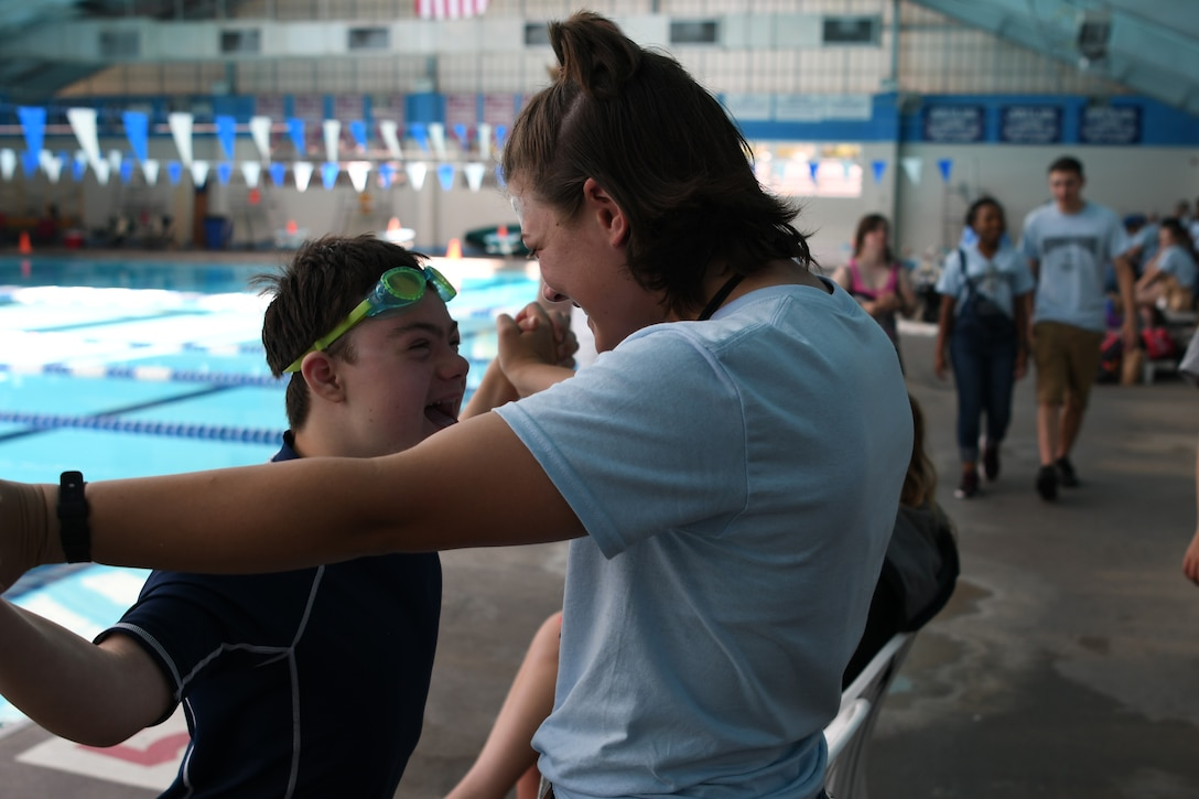 Easton Slutz, District 5 Special Olympics Mississippi athlete, celebrates with U.S. Air Force Airman Kaimryn Hursch, 336th Training Squadron student, during SOMS at the City of Biloxi Natatorium, May 12, 2018. Throughout the SOMS weekend, Slutz's Airman Sponsors spent time and cheered him on while he competed in the 4x100 freestyle relay, 50 meter backstroke and 50 meter freestyle. (U.S. Air Force photo by Airman 1st Class Suzie Plotnikov)