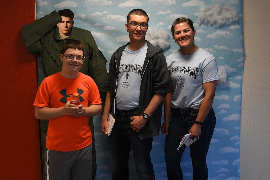 Easton Slutz, District 5 Special Olympics Mississippi athlete, U.S. Air Force Airmen Gabriel Agostini-Mesa and Kaimryn Hursch, 336th Training Squadron students, pose for a picture during SOMS in Smith Manor at Keesler Air Force Base, Mississippi, May 11, 2018. This was Slutz's first year competing in SOMS and Agostini-Mesa and Hursch were assigned as his Airman Sponsors. (U.S. Air Force photo by Airman 1st Class Suzie Plotnikov)