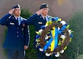 Airman 1st Class Neftali Ramos and Airman 1st Class Thomas Gibbs, assigned to the 514th Security Forces Squadron, part of the 514th Air Mobility Wing at Joint Base McGuire-Dix-Lakehurst, salute a peace officer memorial wreath at the 910th Airlift Wing headquarters flag pole on Youngstown Air Reserve Station May 16 during a peace officer memorial ceremony.
