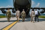 West Virginia National Guard and Qatar defense attaché leadership approach a C-17 Globemaster III from the 167th Airlift Wing as the two forces engage in meetings about the newly formed State Partnership Program May 14, 2018 at McLaughlin Air National Guard Base, Charleston, W.Va.