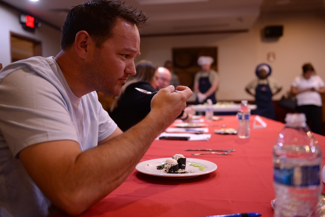 Joe Lucidi, a local restaurant owner, judges an appetizer during the Taste of Luke cooking competition at Luke Air Force Base, Ariz., May 9, 2018. Lucidi was one of three guest judges, the other two were also from local restaurants. (U.S. Air Force photo by Senior Airman Ridge Shan)