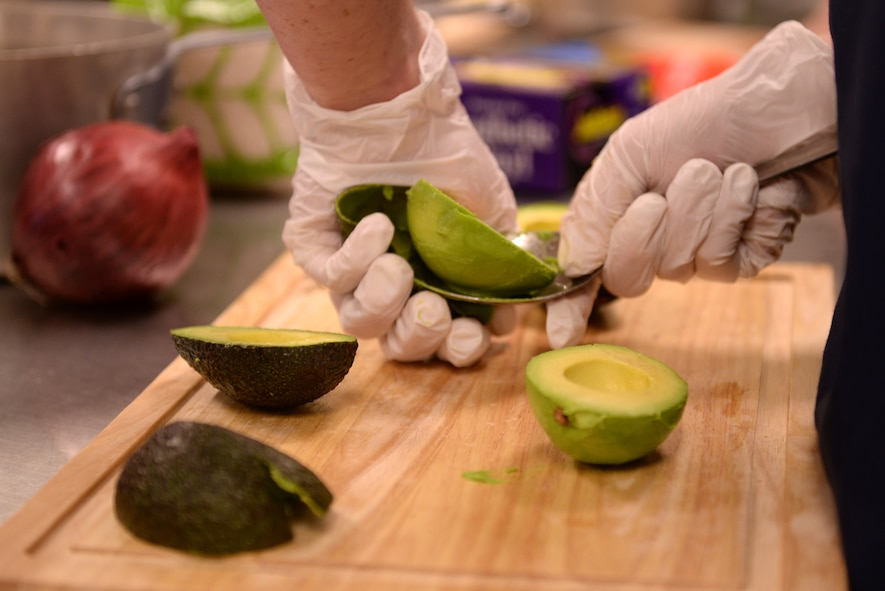 A competitor at the Taste of Luke cooking competition peels an avocado at Luke Air Force Base, Ariz., May 9, 2018. The cooking competition, like others that the 56th Force Support Squadron hosts throughout the year, required competitors to cook three different dishes, an appetizer, an entrée, and a dessert, to complete a three-course meal. (U.S. Air Force photo by Senior Airman Ridge Shan)
