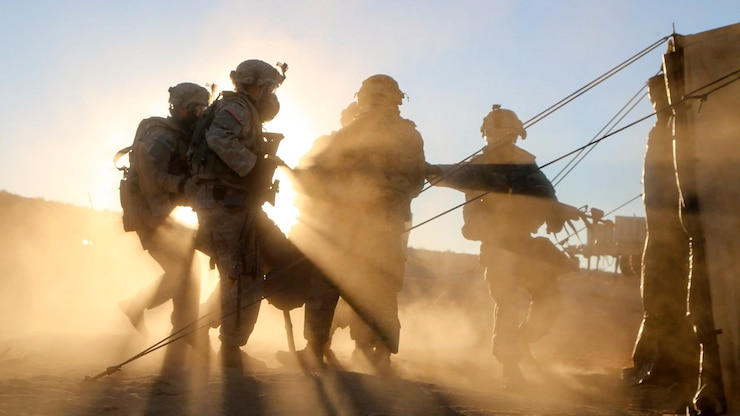 Soldiers carry a casualty.