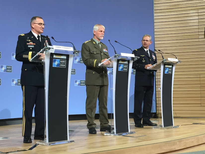 Left to right, U.S. Army Gen. Curtis M. Scaparrotti, NATO's supreme allied commander for Europe; Gen. Petr Pavel of the Czech army, chairman of the NATO Military Committee; and Gen. Denis Mercier of the French air force, NATO's supreme allied commander for transformation, brief reporters on the NATO Military Committee meeting in Brussels.