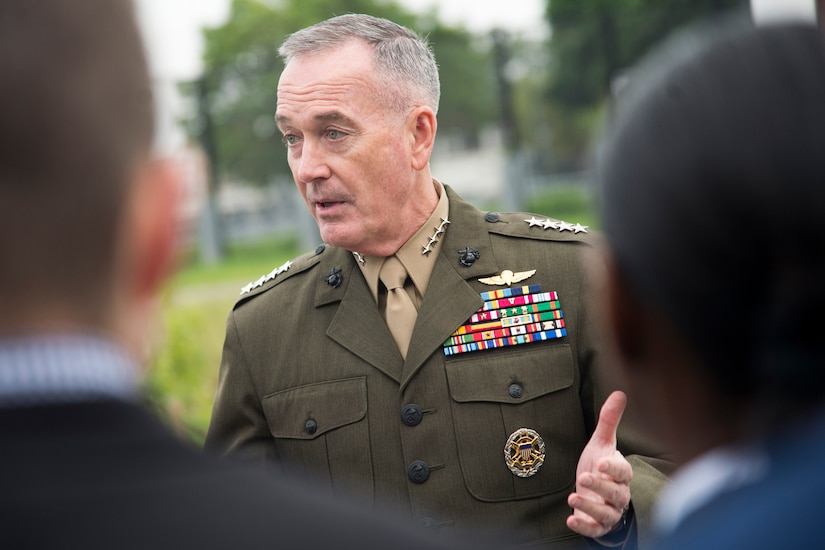 Marine Corps Gen. Joe Dunford speaks to a group of people in Brussels