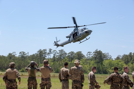 U.S. Marines with II Marine Expeditionary Force Information Group and Dutch Marines observe a UH-1Y helicopter preparing to land during exercise Burmese Chase at Camp Lejeune, N.C., May 11, 2018.Burmese Chase is an annual U.S. led multi-lateral exercise that enables U.S. Marines to train with NATO allies and partner nations. This exercise strengthens partner nation security as well as enhances force readiness. (U.S. Marine Corps photo by Lance Cpl. Caleb Maher)