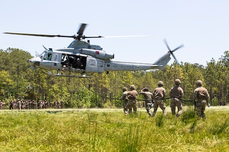 British Commandos hold a rope after fast roping from a UH-1Y helicopter during exercise Burmese Chase at Camp Lejeune, N.C., May 11, 2018. Burmese Chase is an annual U.S. led multi-lateral exercise that enables U.S. Marines to train with NATO allies and partner nations. This exercise strengthens partner nation security as well as enhances force readiness.