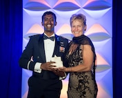 Capt. Michael Nayak receives the 2018 Rotary National Award for Space Achievement Early Career Stellar Award from Dr. Peggy Whitson, NASA astronaut and holder of the U.S. record for time spent in space. Nayak is a planetary scientist and aerospace engineer at the Air Force Research Laboratory's Air Force Maui Optical and Supercomputing site on Maui, Hawaii.
