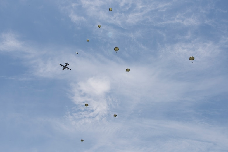 Hellenic paratroopers jump from a U.S. Air Force C-130J Super Hercules during exercise Stolen Cerberus V, over Megara Drop Zone, Greece, May 15, 2018. Hellenic riggers worked with U.S. Army jumpmasters to enhance interoperability between the respective services. (U.S. Air Force photo by Senior Airman Devin M. Rumbaugh)