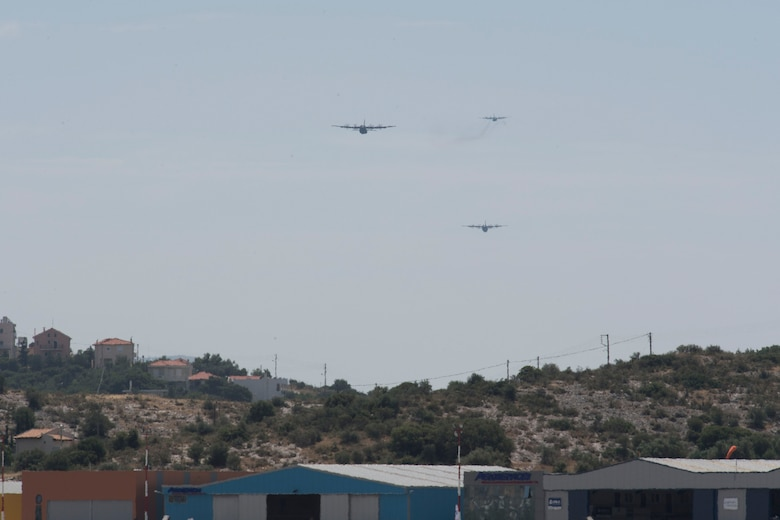Two U.S. Air Force C-130J Super Hercules fly in formation in front of a Hellenic Air Force C-130H Hercules during the final training flight for Stolen Cerberus V, over Megara Drop Zone, Greece, May 15, 2018. Combined interfly missions such as these, enhance the interoperability capabilities and kills among allied and partner armed forces. (U.S. Air Force photo by Senior Airman Devin M. Rumbaugh)