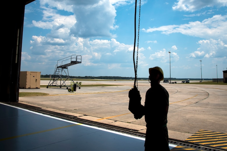 An Airman from the 723d Aircraft Maintenance Squadron (AMXS), operates a lift mechanism, May 10, 2018, at Moody Air Force Base, Ga. Airmen from the 723d AMXS along with machinists from the Corpus Christi Army Depot conducted a full-structural tear down and restoration on an HH-60G Pave Hawk. Once the aircraft was torn down, Airmen and the machinists performed repairs on all of its components prior to resembling it. (U.S. Air Force photo by Airman 1st Class Eugene Oliver)