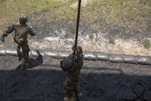 Members of the French Marines fast rope from a rappel tower during exercise Burmese Chase at Camp Lejeune, N.C., May 10, 2018. Burmese Chase is an annual U.S. led multi-lateral exercise that enables U.S. Marines to train with NATO allies and partner nations. This exercise strengthens partner nation security as well as enhances force readiness. (U.S. Marine Corps photo by Lance Cpl. Caleb Maher)