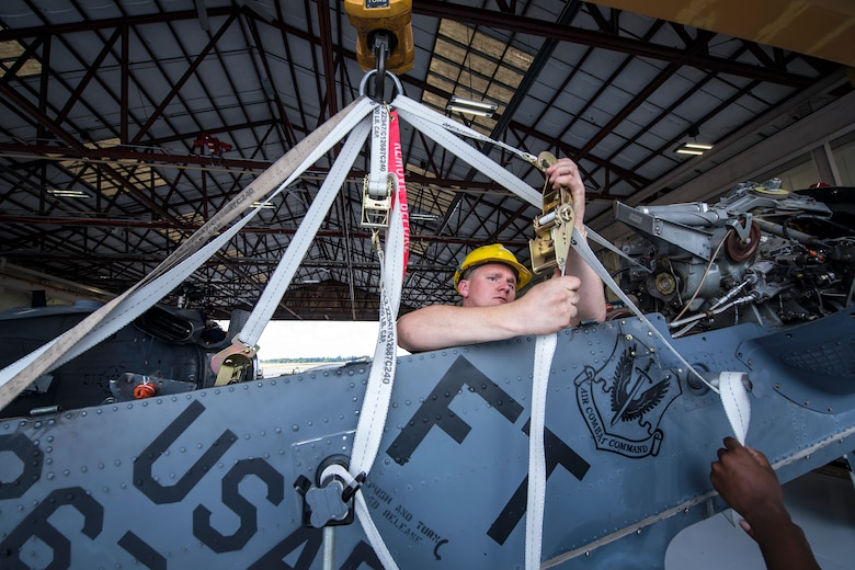 Staff Sgt. David Melton, 723d Aircraft Maintenance Squadron (AMXS) crew chief, attaches a pulley mechanism to an HH-60G Pave Hawk tail pylon, May 10, 2018, at Moody Air Force Base, Ga. Airmen from the 723d AMXS along with machinists from the Corpus Christi Army Depot conducted a full-structural tear down and restoration on an HH-60G Pave Hawk. Once the aircraft was torn down, Airmen and the machinists performed repairs on all of its components prior to resembling it. (U.S. Air Force photo by Airman 1st Class Eugene Oliver)