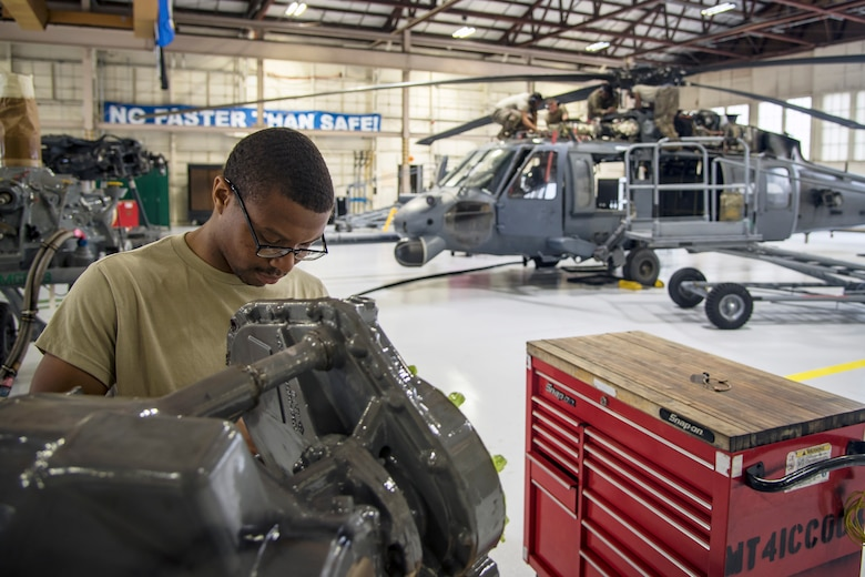 An Airman from the 723d Aircraft Maintenance Squadron (AMXS), inspects an accessory module, May 15, 2018, at Moody Air Force Base, Ga. Airmen from the 723d AMXS along with machinists from the Corpus Christi Army Depot conducted a full-structural tear down and restoration on an HH-60G Pave Hawk. Once the aircraft was torn down, Airmen and the machinists performed repairs on all of its components prior to resembling it. (U.S. Air Force photo by Airman 1st Class Eugene Oliver)