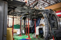Erasmo Leal, a machinist from the Corpus Christi Army Depot (CCAD), inspects his tools, May 15, 2018, at Moody Air Force Base, Ga. Airmen from the 723d Aircraft Maintenance Squadron along with machinists from the CCAD conducted a full-structural tear down and restoration on an HH-60G Pave Hawk. Once the aircraft was torn down, Airmen and the machinists performed repairs on all of its components prior to resembling it. (U.S. Air Force photo by Airman 1st Class Eugene Oliver)