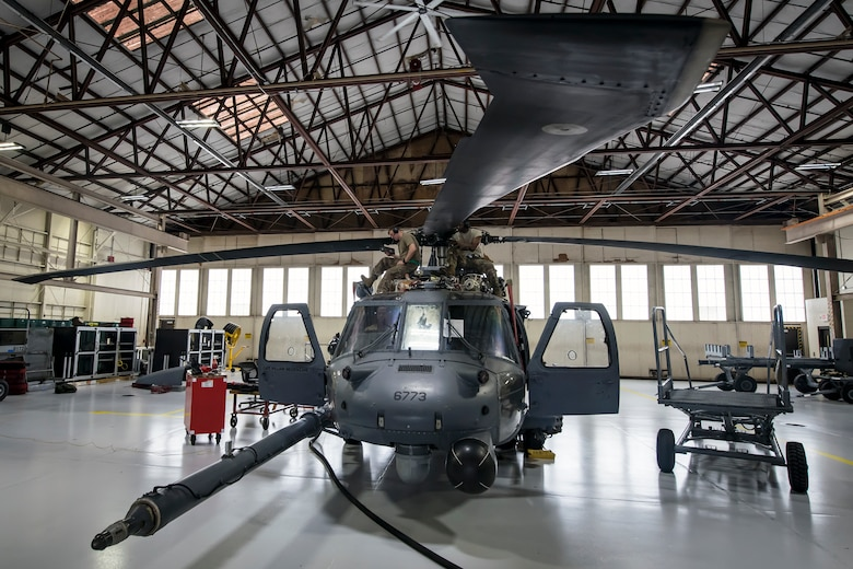 Airmen from the 723d Aircraft Maintenance Squadron (AMXS), repair rotors on an HH-60G Pave Hawk, May 15, 2018, at Moody Air Force Base, Ga. Airmen from the 723d AMXS along with machinists from the Corpus Christi Army Depot conducted a full-structural tear down and restoration on an HH-60G Pave Hawk. Once the aircraft was torn down, Airmen and the machinists performed repairs on all of its components prior to resembling it. (U.S. Air Force photo by Airman 1st Class Eugene Oliver)