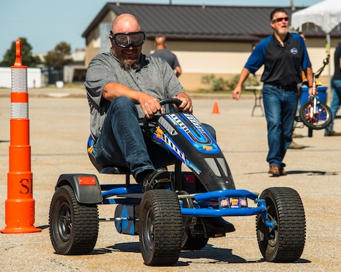 Bryan Crosby pedals through obstacles while wearing impairment goggles during the 4th annual Motorcycle Rodeo May 16, 2018, at Hill Air Force Base, Utah. Base riders also attended one of two mandatory safety briefings given at the base theater, which included guest speakers from the Utah Highway Patrol, wing safety and base leadership.  (U.S. Air Force photo by R. Nial Bradshaw)