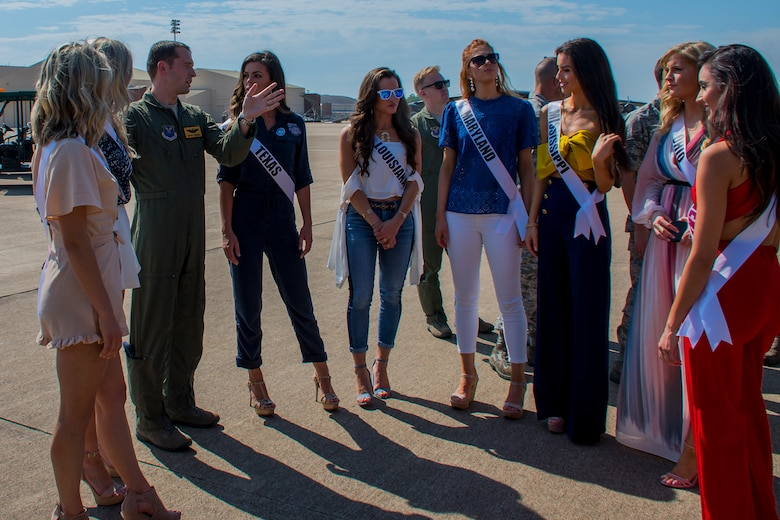 U.S. Air Force Capt. Bryan Freeman, 11th Bomb Squadron pilot, tells contestants in the 2018 Miss USA pageant about the B-52 Stratofortress during their visit to Barksdale Air Force Base, Louisiana, May 15, 2018.