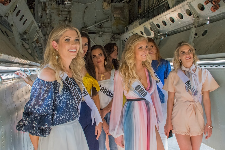 Contestants in the 2018 Miss USA pageant look inside the bomb bay of a B-52 Stratofortress during their visit to Barksdale Air Force Base, Louisiana, May 15, 2018.
