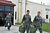 39th FTS Cobra Lieutenants Derek Hall and Jacob Summerhays heading to the flight line for an incentive ride in the T-38. (U.S. Air Force photo by Janis El Shabazz)